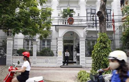 Security stands guard in front of the Denmark embassy in Hanoi