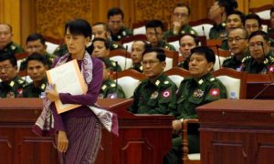 Aung San Suu Kyi walks to take her oath in parliament in Burma