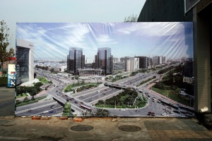 A poster showing the projected view of an urban development on display at the site where investors plan to build it Beijing, China, Tuesday, Nov. 11, 2008. Block after city block, towers of concrete, steel and glass fill the skyline.  Teeming and congested, the intensely urban landscapes of China's biggest cities show a glimpse of what the future will hold for the rest of the country.In the sprawling megacities of Beijing, Shanghai and Chongqing, where populations exceed 10 million people, extreme urban density means that the number of people living within a few square blocks here is equal to the population of entire mid-size U.S. cities.  China's urban population soared to 607 million people last year _ nearly equaling the 700 million living in the countryside. The country's headlong plunge toward urbanization continues unabated as tens of millions of migrants from the countryside flood to cities in search of money, jobs and other opportunities (AP Photo/Elizabeth Dalziel)