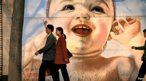 Xian.  Advertising using giant baby image, hoping to exploit Chinese love of children, exaggerated by the government's intrusive one-child policy.Families
