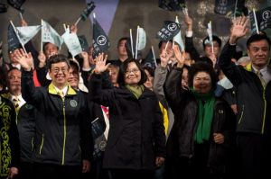 Democratic Progressive Party (DPP) presidential candidate Tsai Ing-wen (C) celebrates her victory inTaipei on January 16, 2016.  Voters in Taiwan elected a Beijing-sceptic president in a dramatic democratic journey, carving their own political path against China's wishes. AFP PHOTO / Philippe Lopez / AFP / PHILIPPE LOPEZ