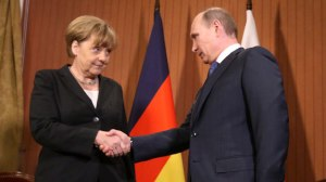 DEAUVILLE, FRANCE - JUNE 06: President Vladimir Putin of Russia shakes hands with Chancellor Angela Merkel of Germany during their meeting in the Barriere Normandy Hotel on June 6, 2014 in Deauville, France. Putin takes part in the celebrations of 70th anniversary the Normandy Landings, also known as ''D-day.'' Sasha Mordovets/Getty Images