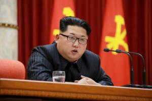 North Korean leader Kim Jong Un speaks during a ceremony to award party and state commendations to nuclear scientists, technicians, soldier-builders, workers and officials for their contribution to what North Korea said was a succesful hydrogen bomb test, at the meeting hall of the Central Committee of the Workers' Party of Korea (WPK) in this undated photo released by North Korea's Korean Central News Agency (KCNA) on January 13, 2016.  REUTERS/KCNA