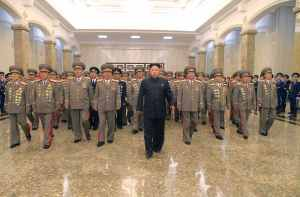 "North Korean leader Kim Jong Un (C) visits the Kumsusan Palace of the Sun to pay tribute to founding President Kim Il Sung and former leader Kim Jong Il to mark the 61st anniversary of the victory of the Korean people in the Fatherland Liberation War, in this file photo released by North Korea's Korean Central News Agency (KCNA) in Pyongyang July 27, 2014. Kim is suffering from ""discomfort"", state media has said in the first official acknowledgement of ill health after a prolonged period out of the public eye. Kim, 31, who is frequently the centrepiece of the isolated country's propaganda, has not been photographed by state media since appearing at a concert alongside his wife on September 3, fuelling speculation he is suffering from bad health. He had been seen walking with a limp since an event with key officials in July and in a pre-recorded documentary broadcast by state media on September 25, 2014 appeared to have difficulty walking. REUTERS/KCNA (NORTH KOREA - Tags: POLITICS PROFILE TPX IMAGES OF THE DAY ANNIVERSARY) ATTENTION EDITORS - THIS PICTURE WAS PROVIDED BY A THIRD PARTY. REUTERS IS UNABLE TO INDEPENDENTLY VERIFY THE AUTHENTICITY, CONTENT, LOCATION OR DATE OF THIS IMAGE. FOR EDITORIAL USE ONLY. NOT FOR SALE FOR MARKETING OR ADVERTISING CAMPAIGNS. THIS PICTURE IS DISTRIBUTED EXACTLY AS RECEIVED BY REUTERS, AS A SERVICE TO CLIENTS. NO THIRD PARTY SALES. NOT FOR USE BY REUTERS THIRD PARTY DISTRIBUTORS. SOUTH KOREA OUT. NO COMMERCIAL OR EDITORIAL SALES IN SOUTH KOREA"