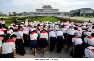 north-korean-students-bow-in-front-of-kumsusan-palace-of-the-sun-where-gf5kff